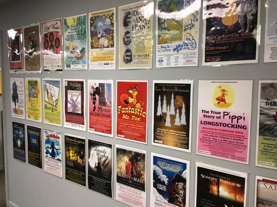 Posters from past productions are found all over the lobby of KCT on Churchwell Avenue. April 16, 2019.