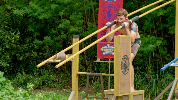 """Gavin Whitson competes in an immunity challenge on """"Survivor: Edge of Extinction."""""""
