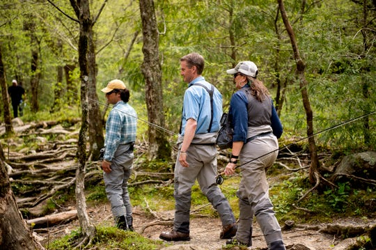 U.S. Rep. Tim Burchett walks down a trail with Ian and Charity Rutter, of R&R Fly Fishing, to fly fish at Metcalf Bottoms Picnic Pavilion in the Great Smoky Mountains in Tennessee on Thursday, April 18, 2019. Congressman Burchett was fly fishing in the Smokies to shed light on backlogged projects within the park as well as to support funding for all national parks across the country.