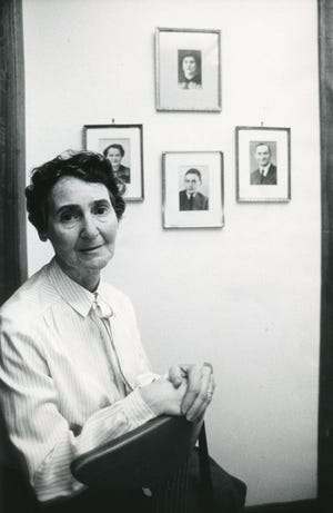 Mira Kimmelman with portraits of her family, April 1987.