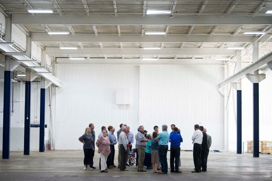 Local officials and visitors tour the opening of Protomet's $30 million plant in Loudon County on Thursday, April 18, 2019.