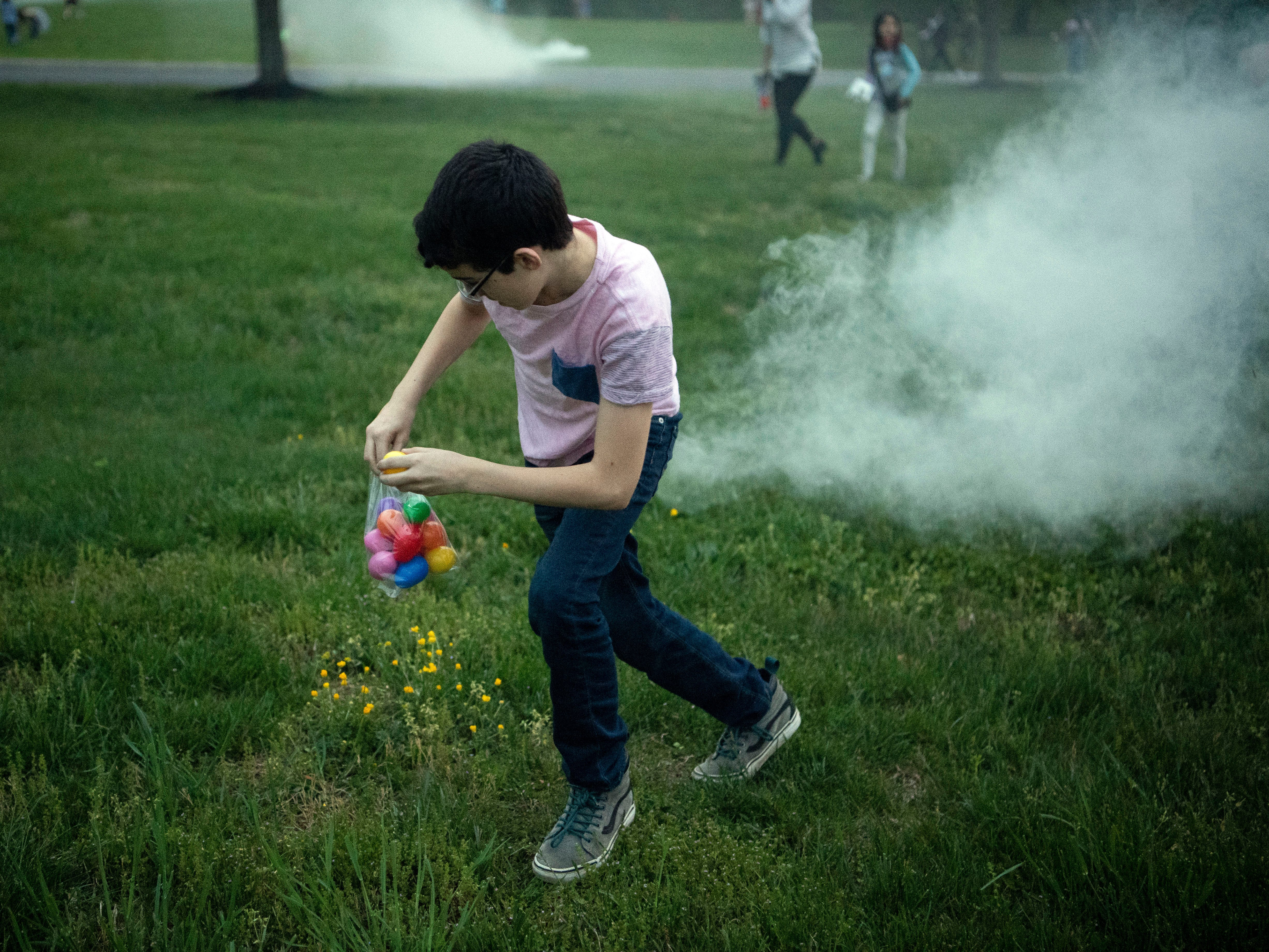 Amid smoke bombs, Faith Promise Church's North Campus holds a Battle Royale-themed Easter egg hunt where teens searched for eggs while trying to avoid being hit by foam darts on Wednesday, April 17, 2019.