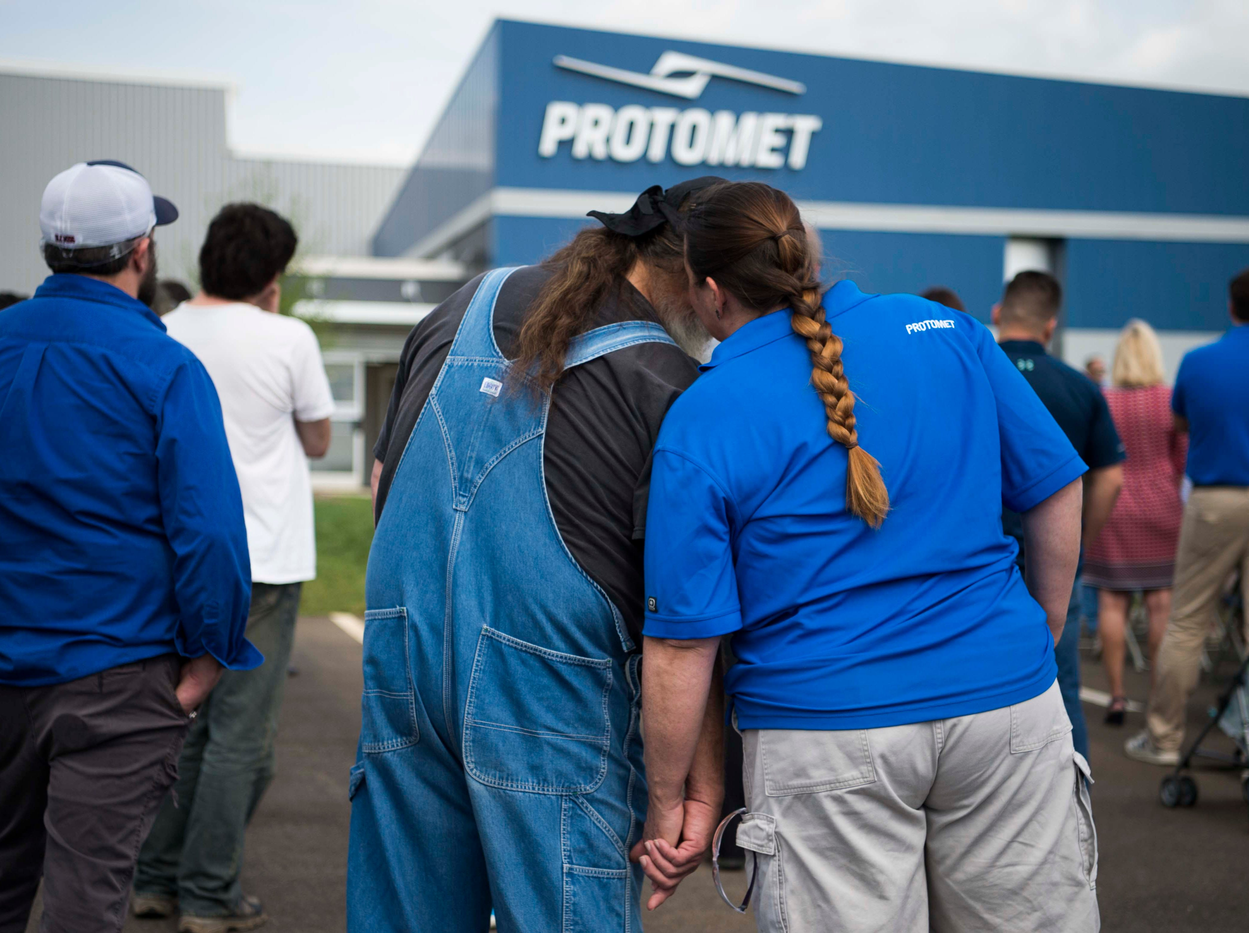 A couple shares conversation at the opening of Protomet Corporation's $30 million, 244,000 square foot plant in Loudon County Thursday, April 18, 2019. When fully staffed the facility will create 200 new jobs for Loudon County.