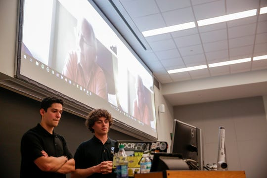 Dr. Andy Aldrin, top, asks questions to Jack Shirocky, left, and Andrew Lang after they presented their teams findings on a solution to better send people to the moon and Mars to Dr. Aldrin, son of astronaut Buzz Aldrin, Thursday, April 18, 2019 at Purdue University in West Lafayette.