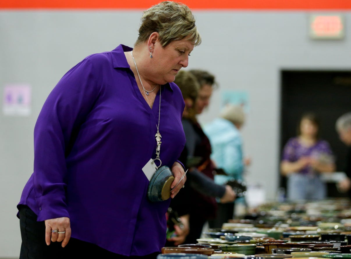 Linda Carter of West Lafayette selects a bowl during the 18th annual Clay Bowl Giving Project, Thursday, April 18, 2019 at the YWCA Greater Lafayette in Lafayette. Local potters donated the clay bowls. The event benefits YWCA's Domestic Violence Intervention and Prevention Program.