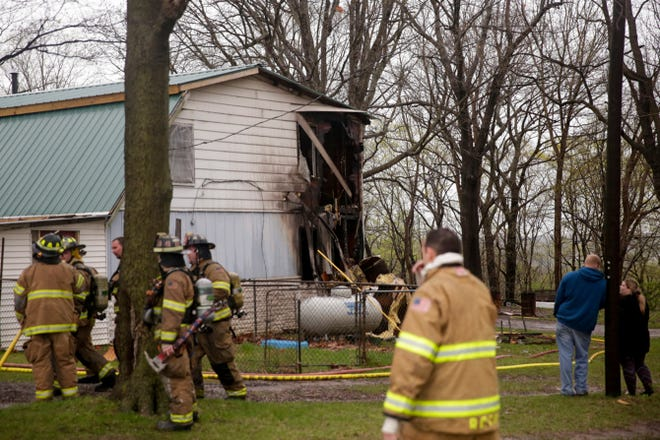 Fire fighters work the scene of a structure fire on Old State road 25 at the Tippecanoe/Carroll county lines, Thursday, April 18, 2019 in Delphi.
