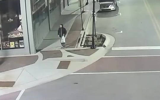 Surveillance footage at Sixth and Main street in downtown Lafayette shows a man who was passing out recruiting fliers for the Ku Klux Klan early Tuesday, April 16, 2019