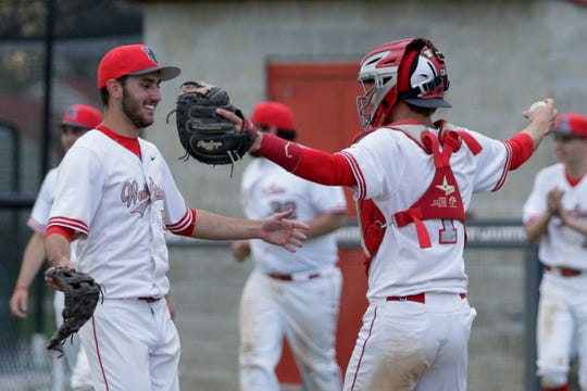 West Lafayette catcher Owen Walbaum (1) and West Lafayette pitcher Tyler Wiseman (5) react after defeating Central Catholic, 3-1, Wednesday, April 17, 2019 in West Lafayette.