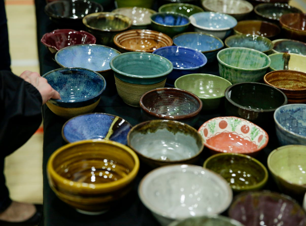 Guests select their bowls during the 18th annual Clay Bowl Giving Project, Thursday, April 18, 2019 at the YWCA Greater Lafayette in Lafayette. Local potters donated the clay bowls. The event benefits YWCA's Domestic Violence Intervention and Prevention Program.