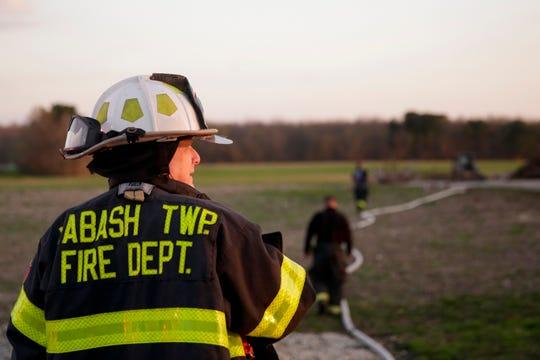 Wabash Township fire department deputy chief Jim Lewis watches as fire fighters work the scene of a structure fire on the 5300 block of Jackson Highway, Wednesday, April 17, 2019 in Wabash Township.
