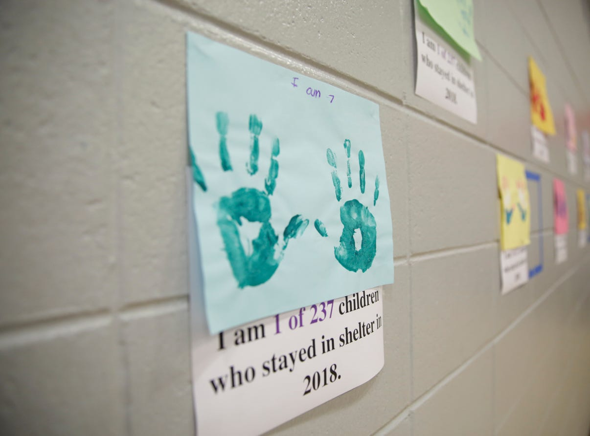 Hand prints from children that stayed in the YWCA domestic violence shelter in 2018 line the walls during the 18th annual Clay Bowl Giving Project, Thursday, April 18, 2019 at the YWCA  Greater Lafayette in Lafayette. Local potters donated the clay bowls. The event benefits YWCA's Domestic Violence Intervention and Prevention Program.