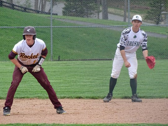 Berne Union's Drew Berstler leads off second base while Fisher Catholic shortstop Dylan Piko tries to keep him close  during Wednesday's Mid-State League-Cardinal Division game. The Irish won 7-6.