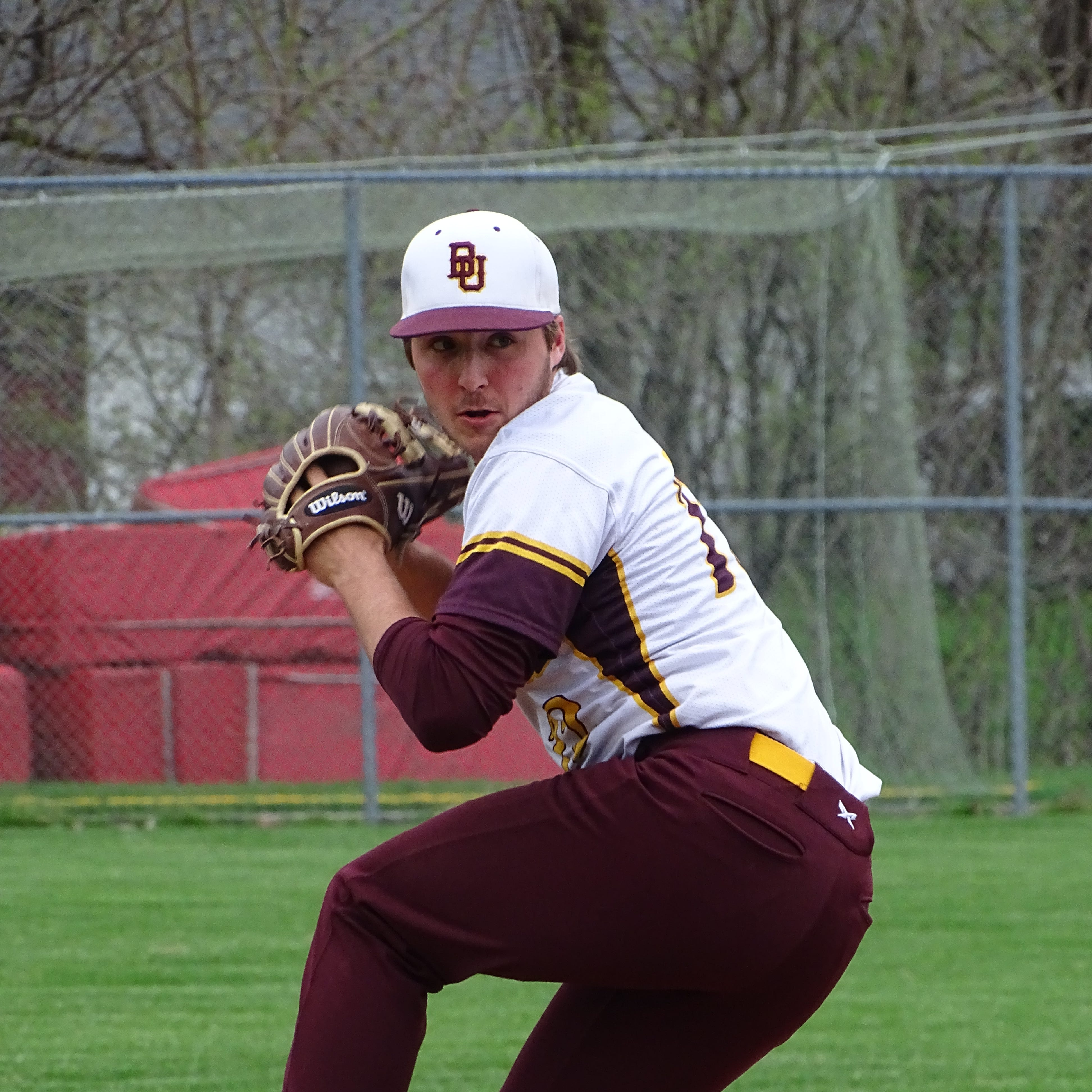 Berne Union senior pitcher Zane Mirgon gets set to throw a pitch against Fisher Catholic on Wednesday.