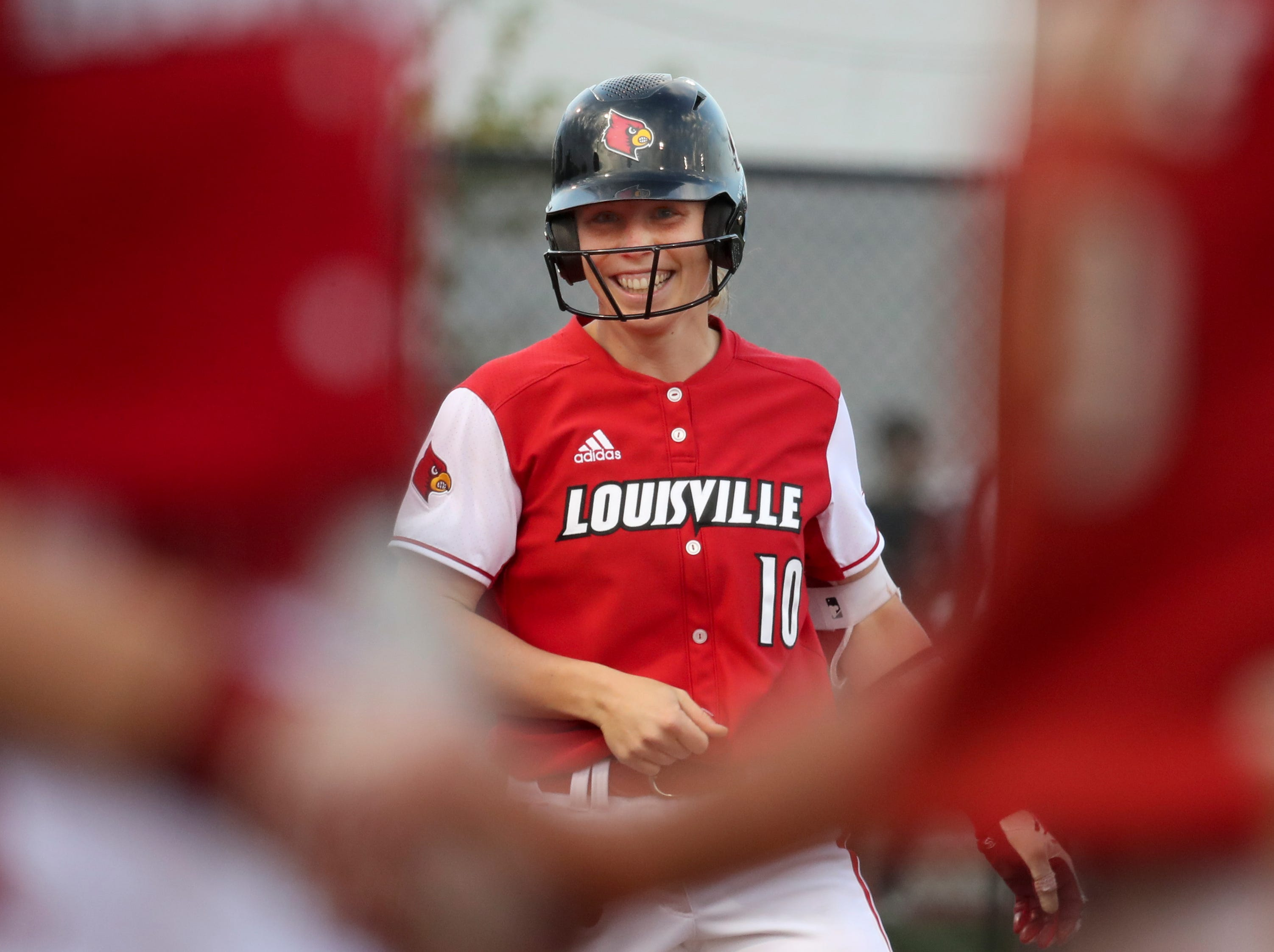 Louisville's Megan Hensley celebrates after smashing a 2 rbi triple against Kentucky on April 17.
