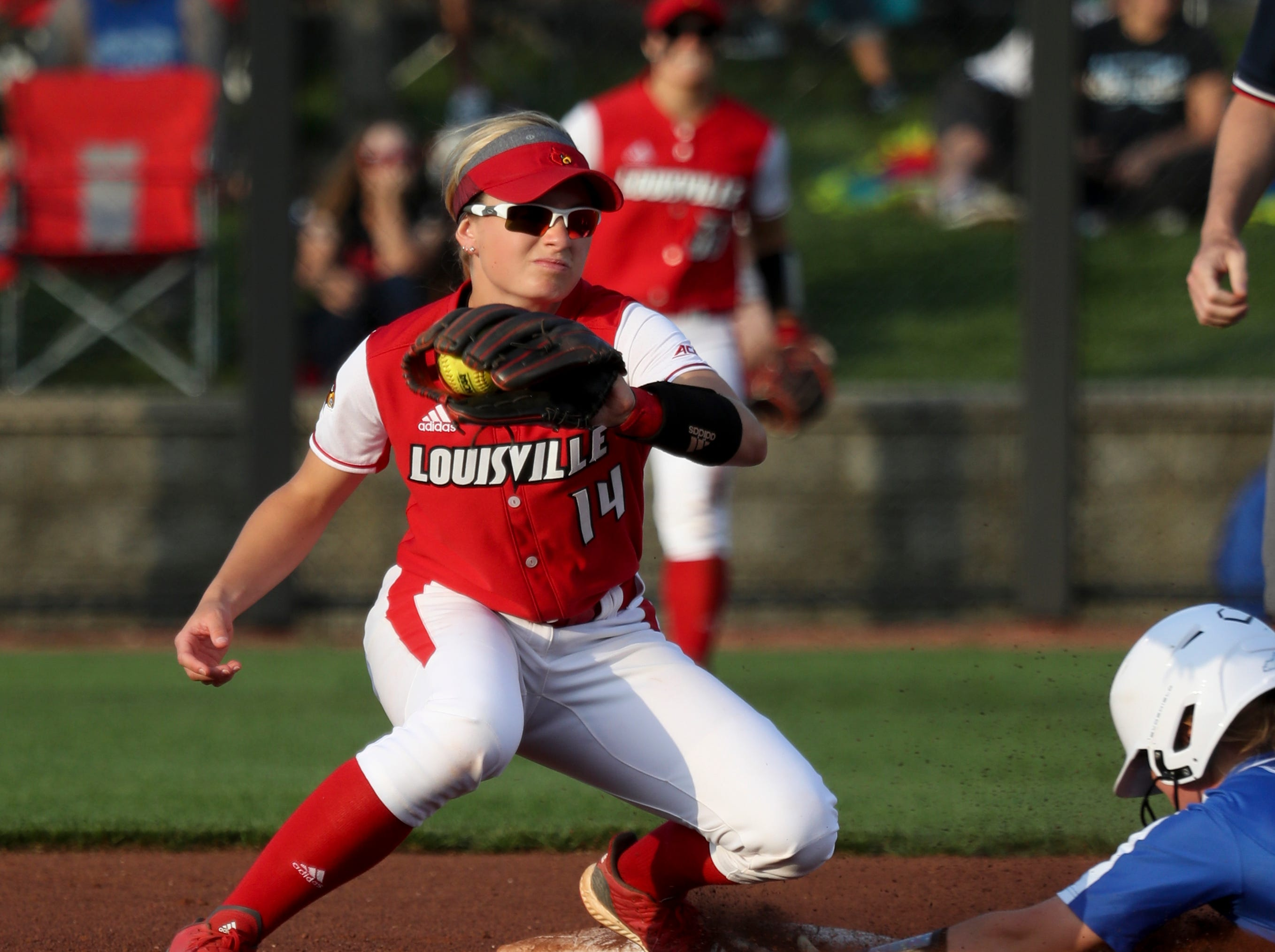 Louisville's Caitlin Ferguson does not get the ball in time to apply the tag against Kentucky on April 17.