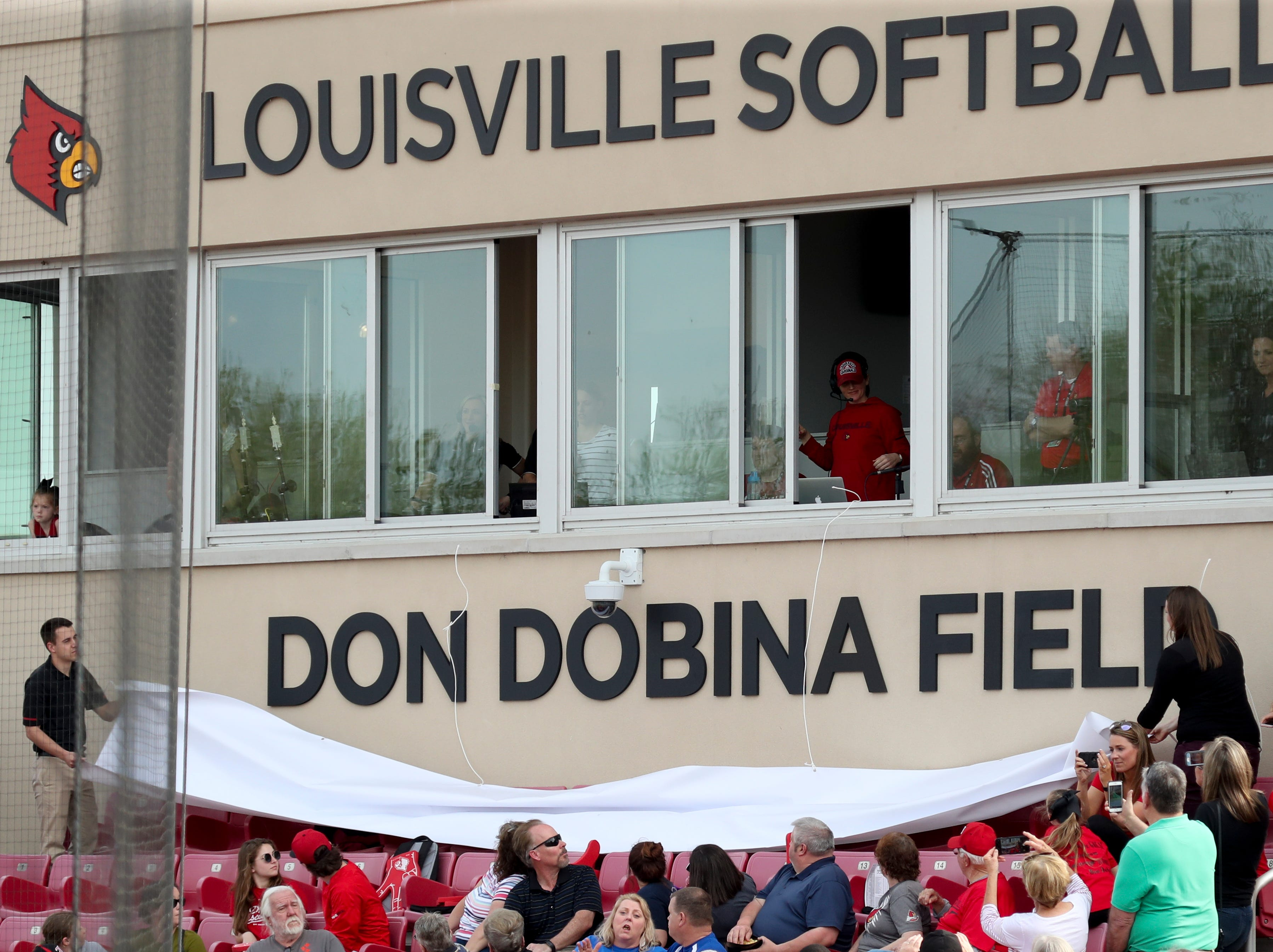 Louisville softball dedicated Don Dobina Field before their game against Kentucky on April 17.