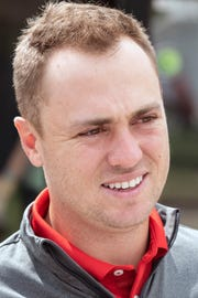 Justin Thomas smiles at Thursday's event.