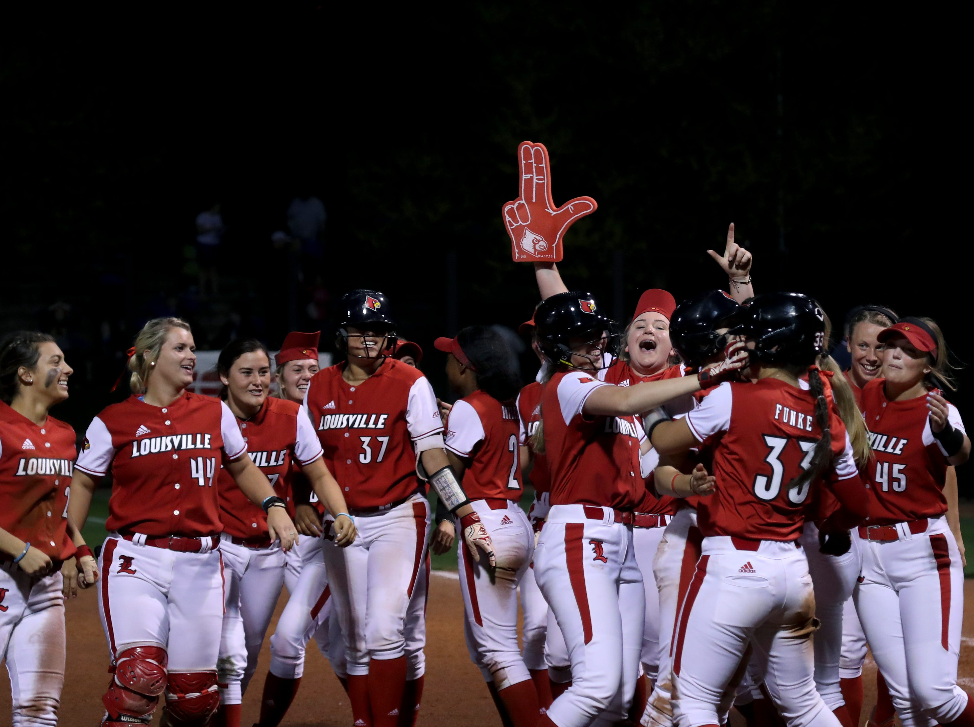 Louisville softball celebrates a victory over Kentucky on April 17.
