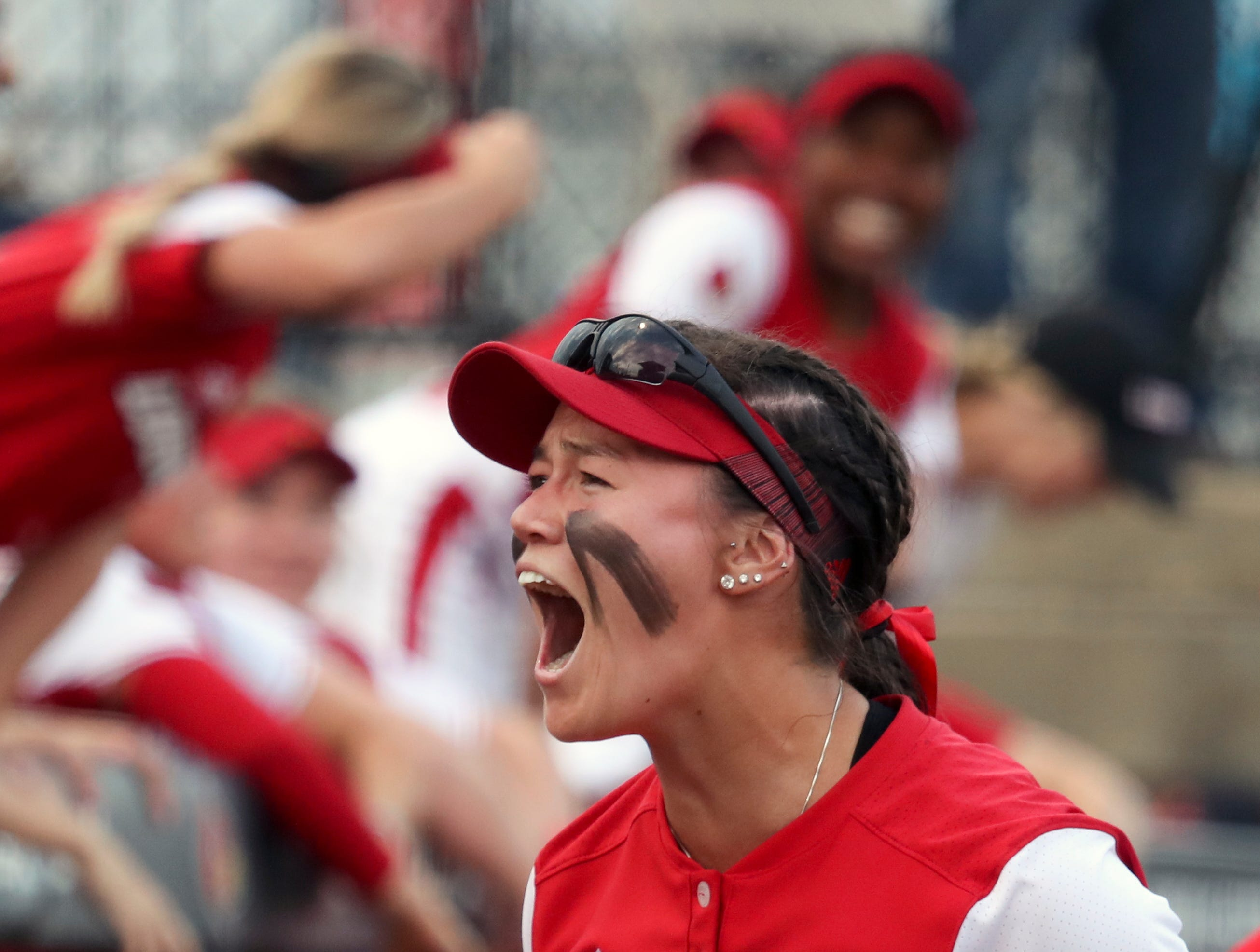 Louisville's Celene Funke gets the crowd pumped up as the Cards take on their rival Kentucky on April 17.