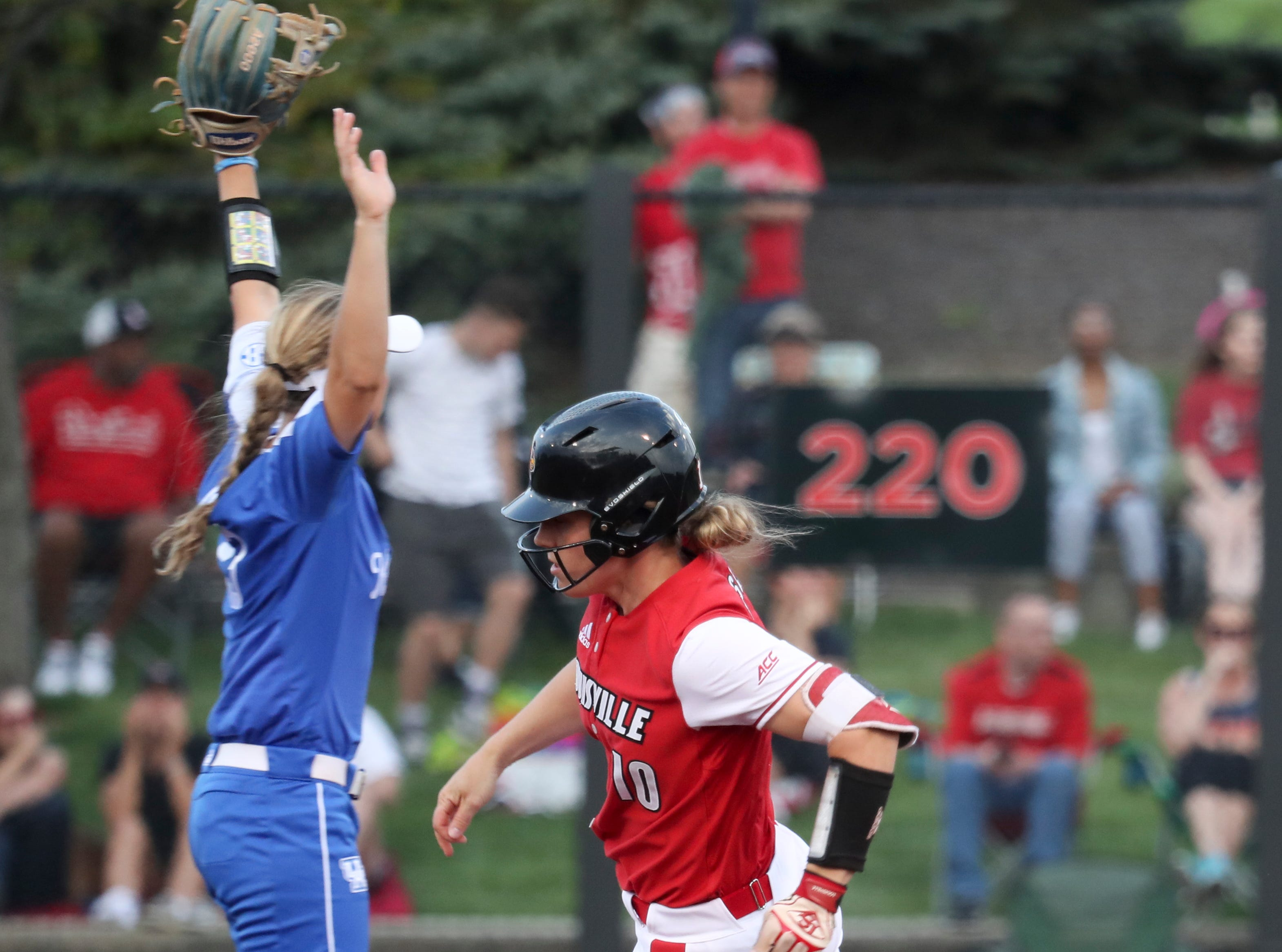 Louisville's Megan Hensley rounds second on her way to a 2 rbi triple against Kentucky on April 17.