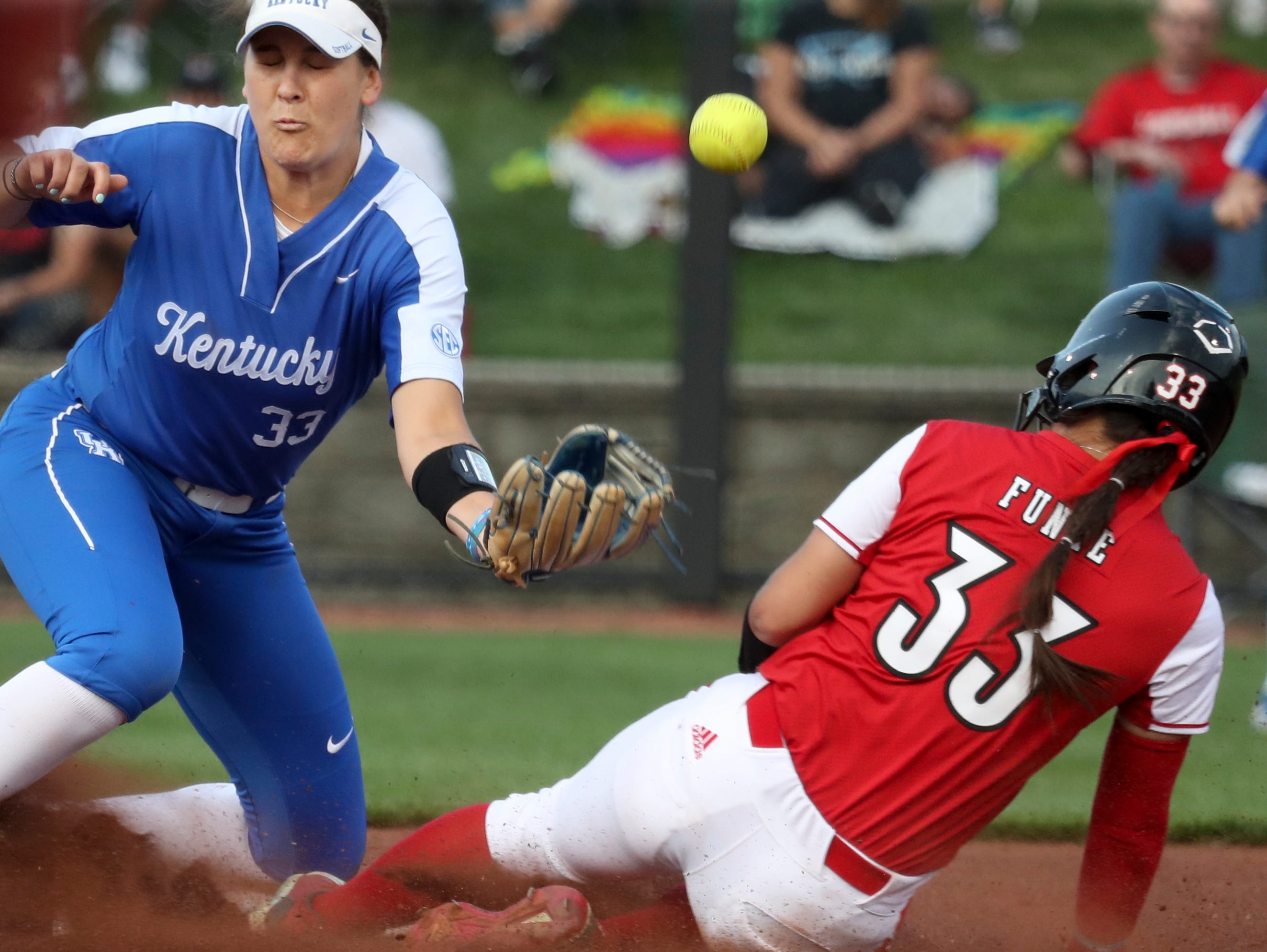 Louisville's Celene Funke slides in to second before the ball gets to Kentucky's Alex Martens on April 17.