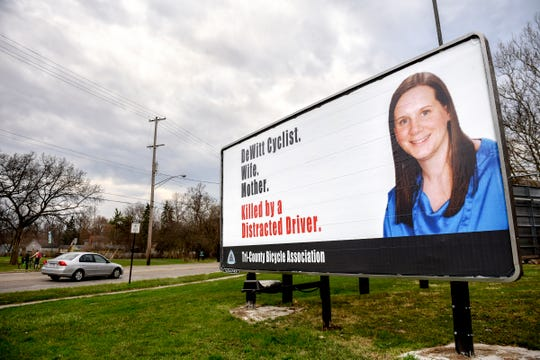 One of two new billboards put up in honor of Jill Byelich, the DeWitt cyclist and mother of two who was killed on September 2, 2014 by a distracted driver, is photographed on Wednesday, April 18, 2019, on Kalamazoo Street near the intersection of Francis Street in Lansing.