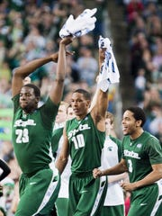 Draymond Green (from left), Delvon Roe and Chris Allen celebrate a dunk by teammate Raymar Morgan with 3:18 remaining in their NCAA Championship semifinal game with Connecticut on Saturday, April 4, 2009, in Detroit.