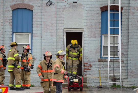 Mansfield firefighters respond to a structure fire at 240 North Adams Street on April 18, 2019.