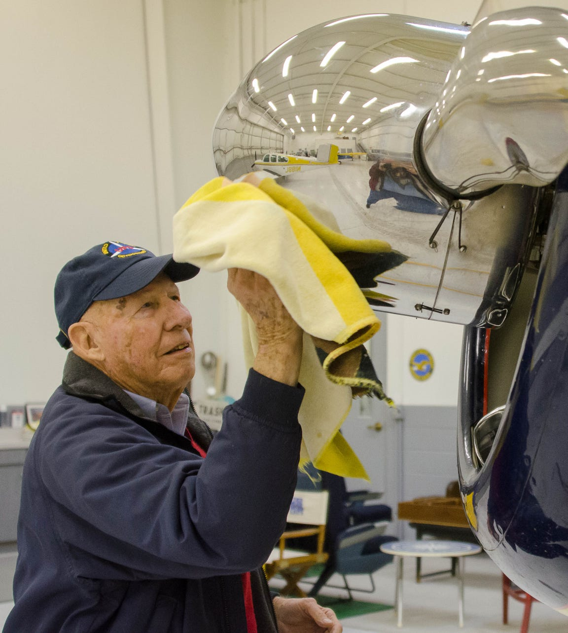 Jim Gorman polishes the propeller dome of his 1941 Beechcraft Staggerwing biplane that he still flies. Dave Polcyn/News Journal file photo