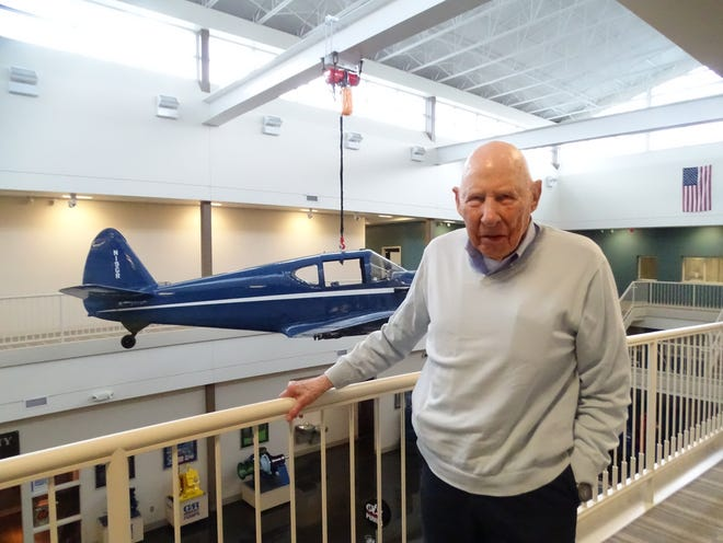Jim Gorman stands next to the company's first corporate plane, a 1949 Temco Swift, which hangs inside the Gorman Rupp Co. on South Airport Road.