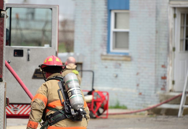 A Mansfield firefighter responds to a structure fire at 240 North Adams on April 18, 2019.