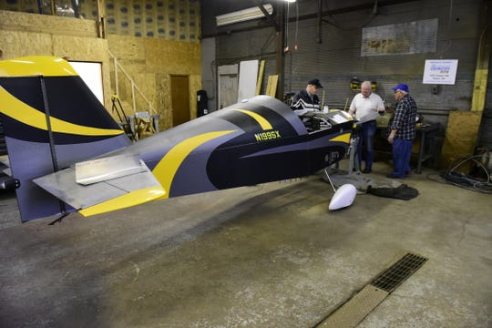 Members of EAA chapter 148 in Galion look over the Sonex kit airplane they are building.