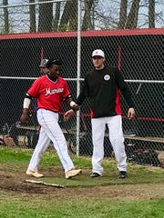 Marion Harding baseball coach Travis Boley watches as Kwauve Booker walks back to the Presidents' dugout in a game last season. The Prexies graduated the bulk of their 2019 team and were looking to rebuild with lots of new faces this spring before the season was canceled.
