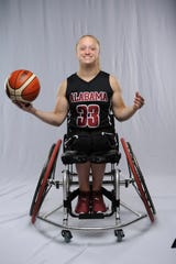 After a gymnastics accident left her paralyzed from the waist down as a 13-year-old, Houston High grad Avery Downing won a national championship with the University of Alabama's women's wheelchair basketball team this year.
