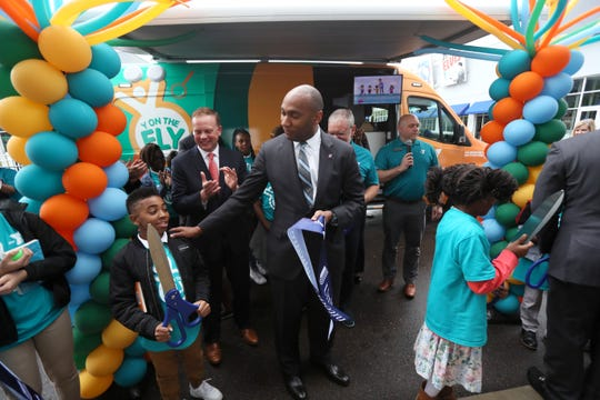 Shelby County Mayor Lee Harris joins the YMCA as they announce their 'Y on the Fly' program at the Graceland soundstage in Whitehaven on Thursday, April 18, 2019. The Y-without-walls concept comes with two vans that will deliver programs and services to young people who don't live near a YMCA.