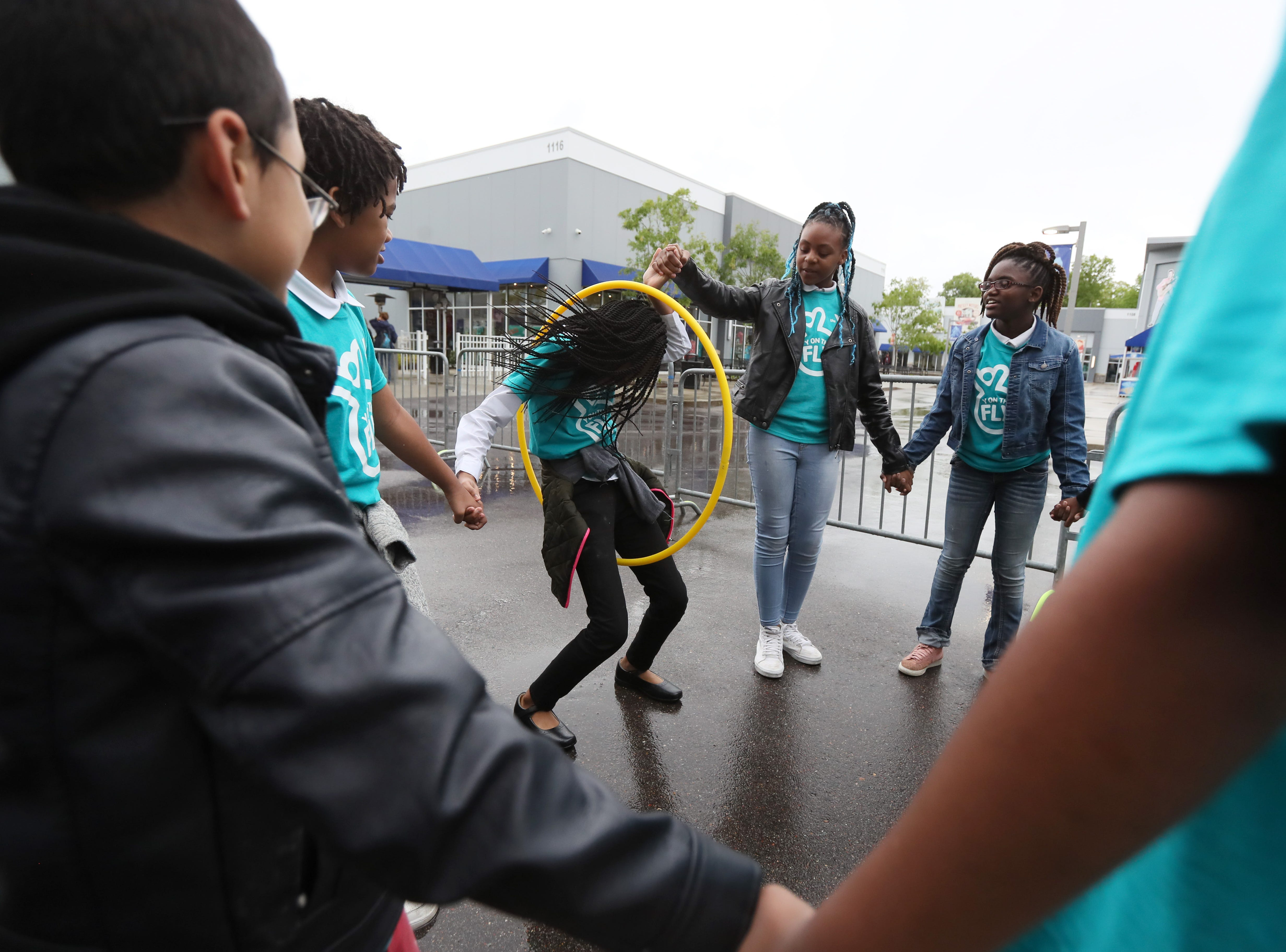Children play alongside the YMCA announcement of their 'Y on the Fly' program at the Graceland soundstage in Whitehaven on Thursday, April 18, 2019. The Y-without-walls concept comes with two vans that will deliver programs and services to young people who don't live near a YMCA.