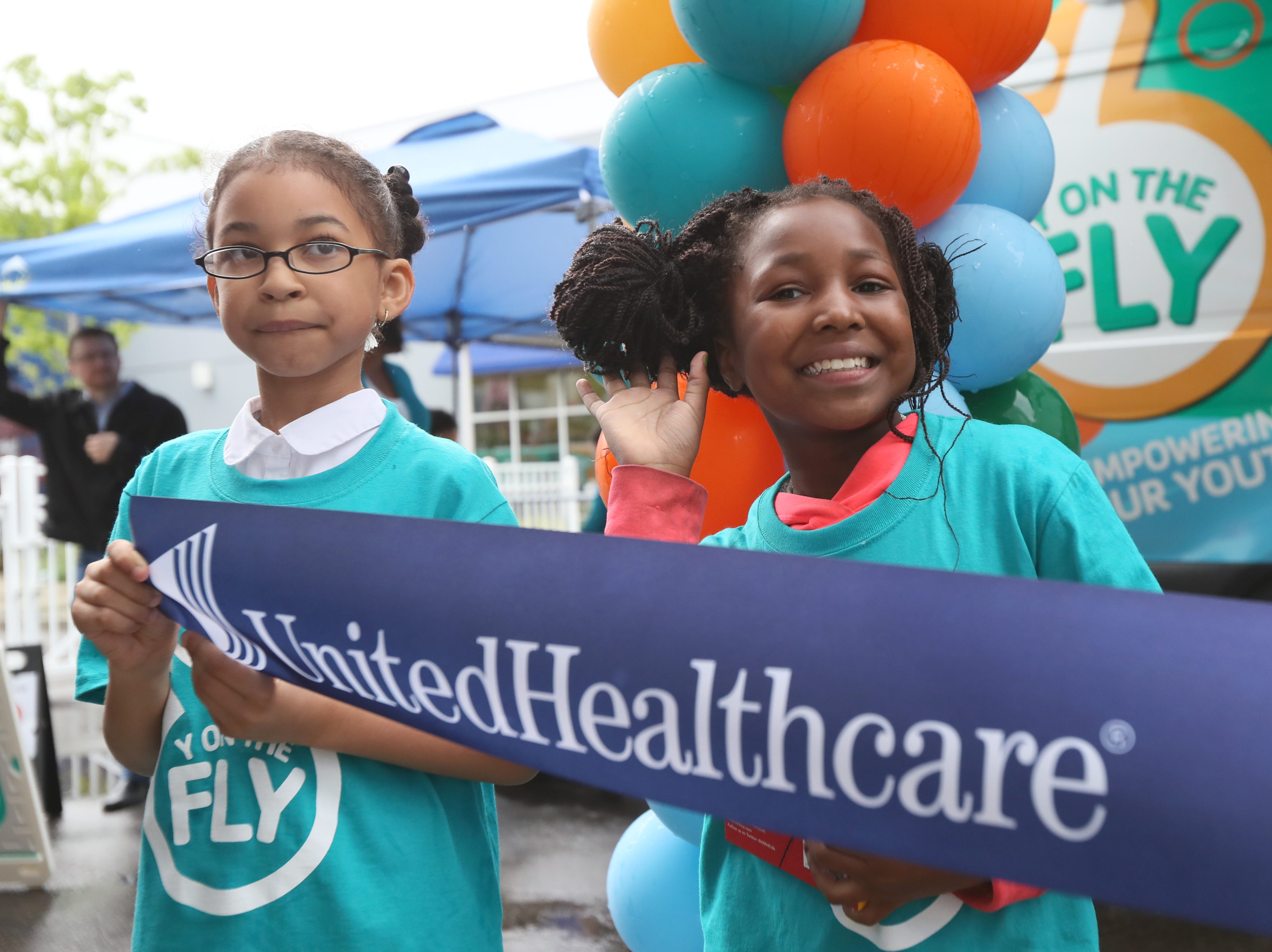 Taylor Dent, 7, left, and Zade White, 9, prepare for the official ribbon cutting as the YMCA announces their 'Y on the Fly' program at the Graceland soundstage in Whitehaven on Thursday, April 18, 2019. The Y-without-walls concept comes with two vans that will deliver programs and services to young people who don't live near a YMCA.