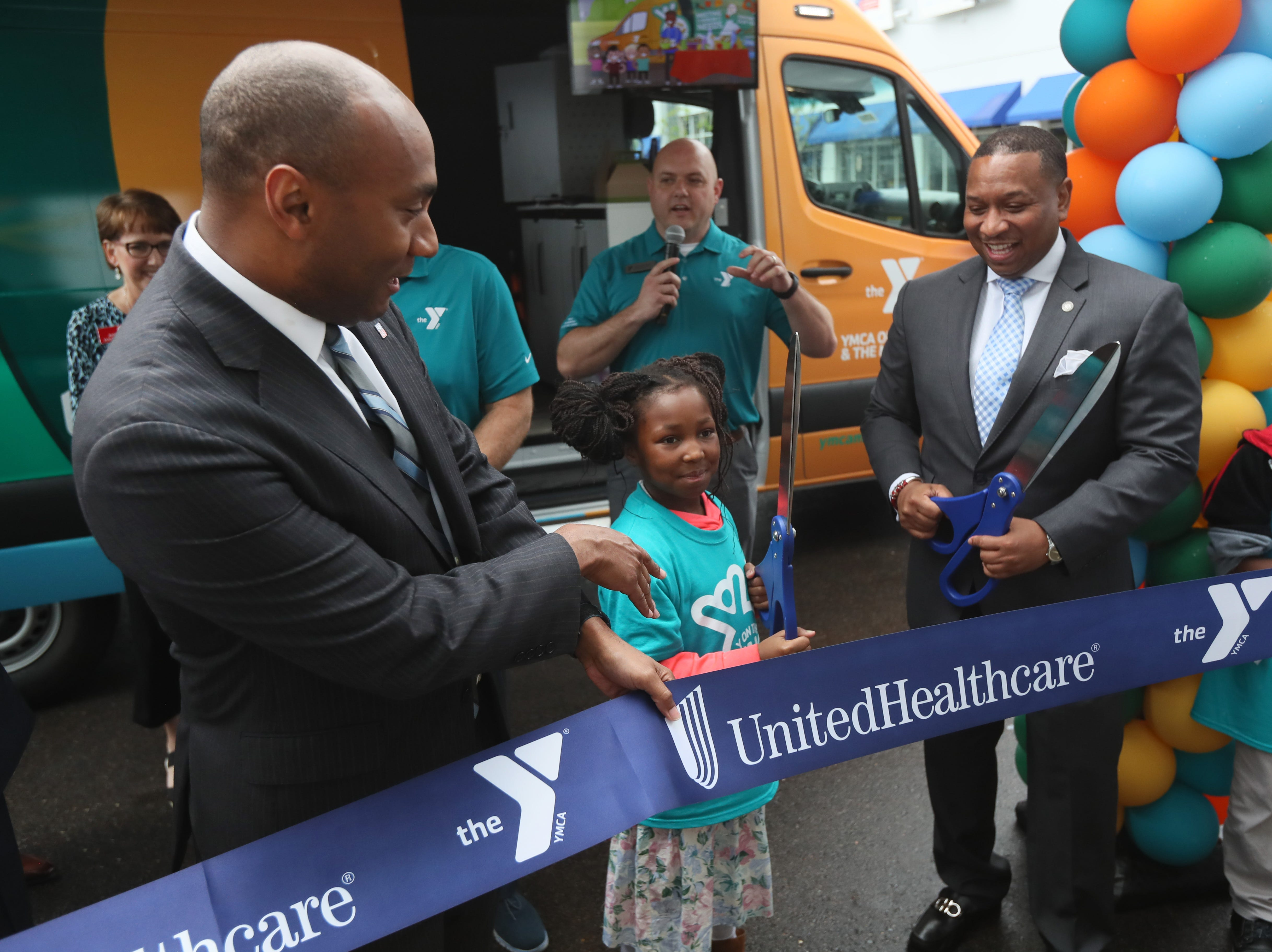 Shelby County Mayor Lee Harris joins Zade White, 9, and Shelby County Schools Interim Superintendent Joris Ray as they help the YMCA announce their 'Y on the Fly' program at the Graceland soundstage in Whitehaven on Thursday, April 18, 2019. The Y-without-walls concept comes with two vans that will deliver programs and services to young people who don't live near a YMCA.