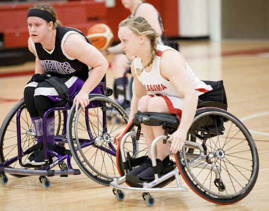 Houston High grad Avery Downing went to Alabama, in part, because of the Crimson Tide's extensive adaptive sports program.