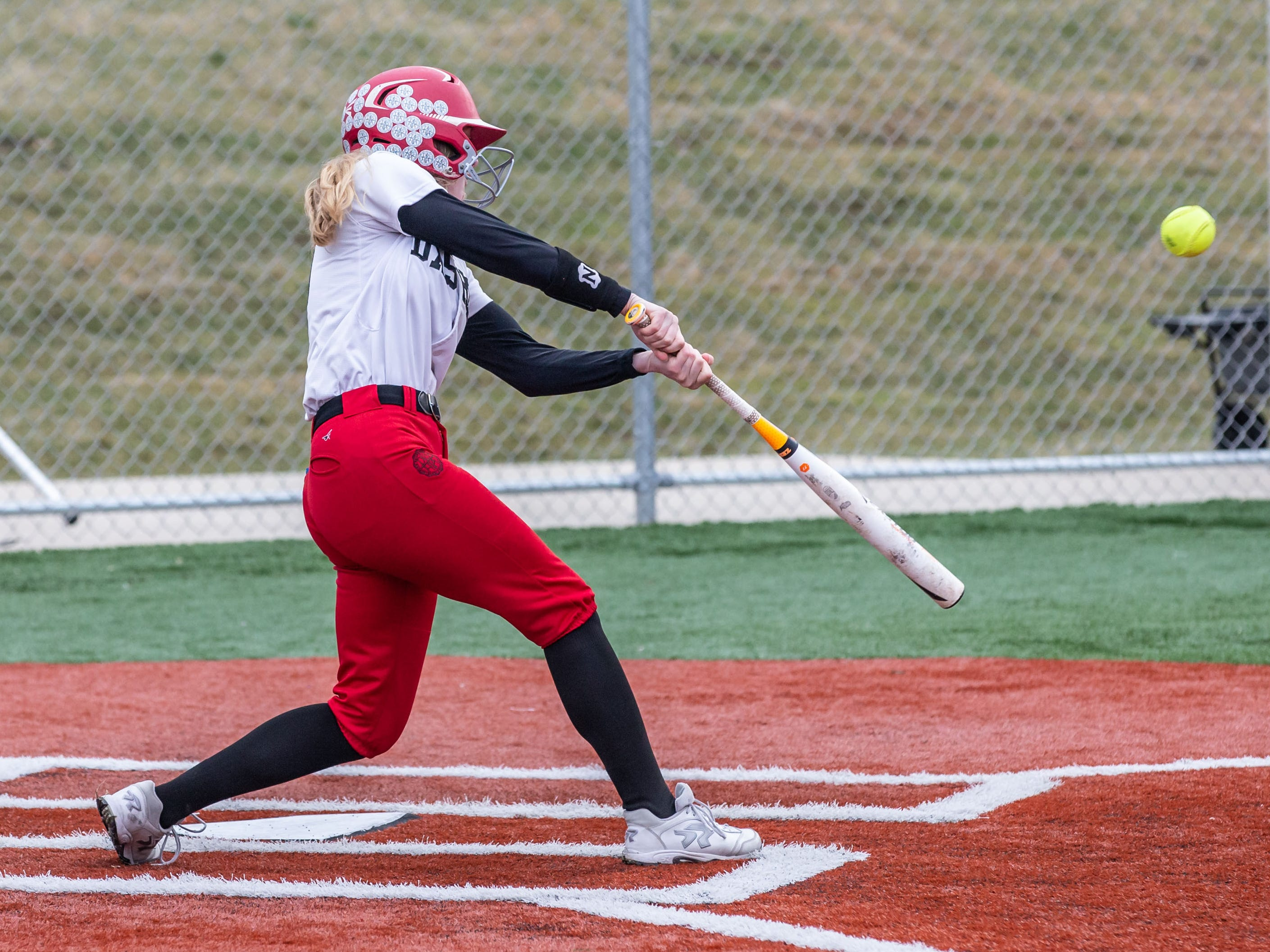 DSHA's Jackie Dooge connects for a triple during the game at Wauwatosa West on Wednesday, April 17, 2019.