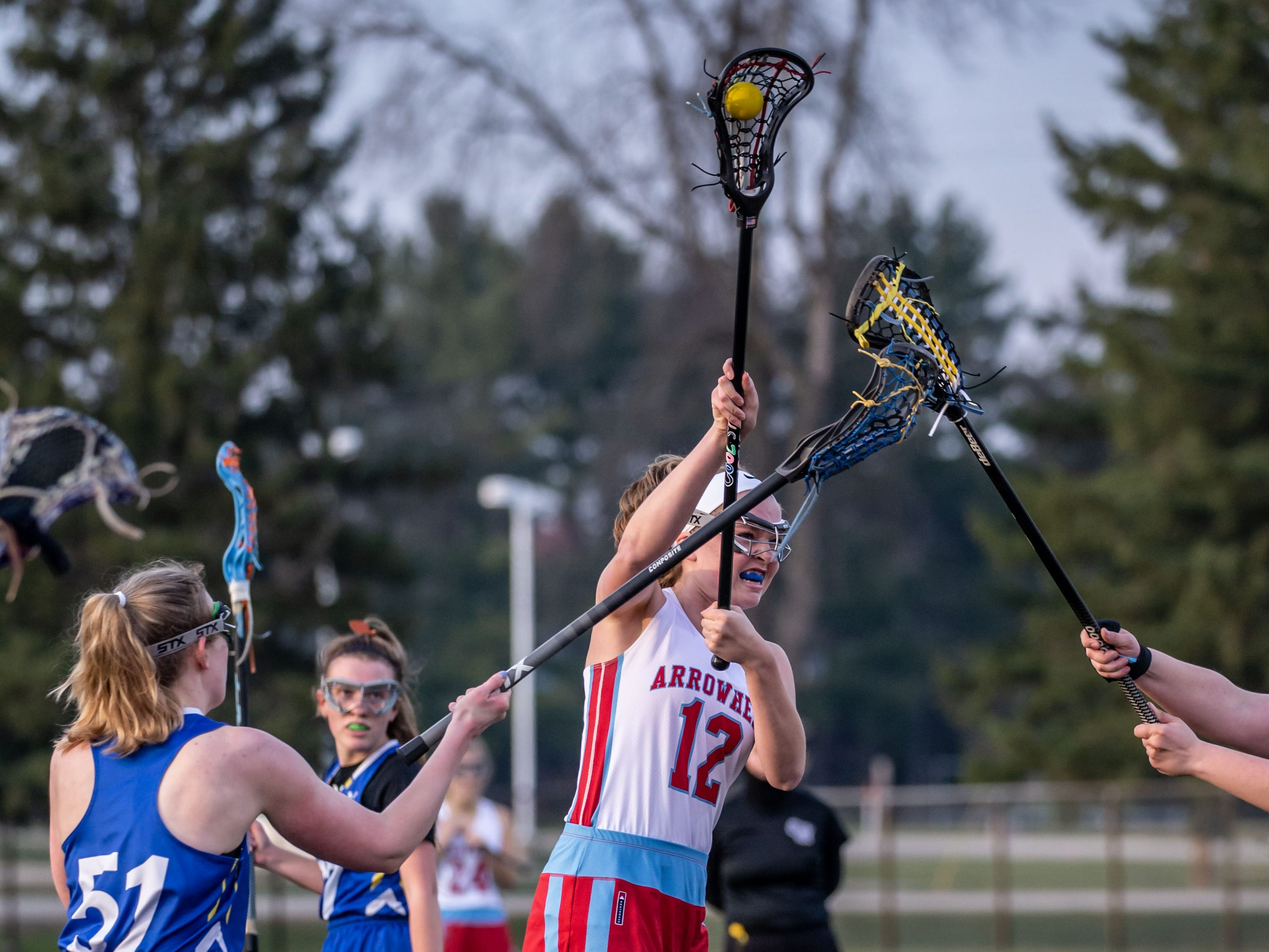 Arrowhead's Coryn Tormala (12) takes a shot on goal during the game at home against Mukwonago on Tuesday, April 16, 2019.