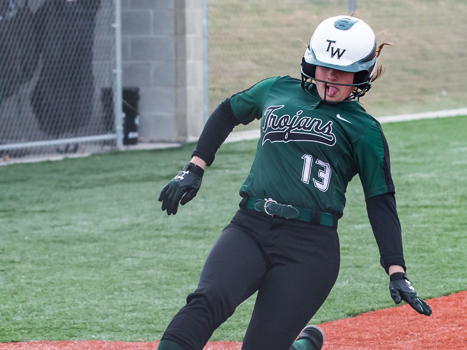 Wauwatosa West's Tess Helbig slides in for a run during the game at home against DSHA on Wednesday, April 17, 2019.