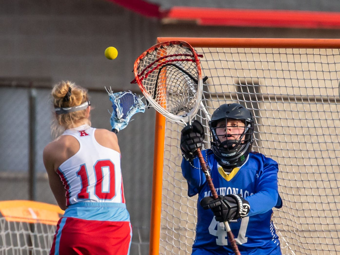 Arrowhead's Steph Curry (10) scores on Mukwonago goalie Izabella Kaczik (47) during the game at Arrowhead on Tuesday, April 16, 2019.