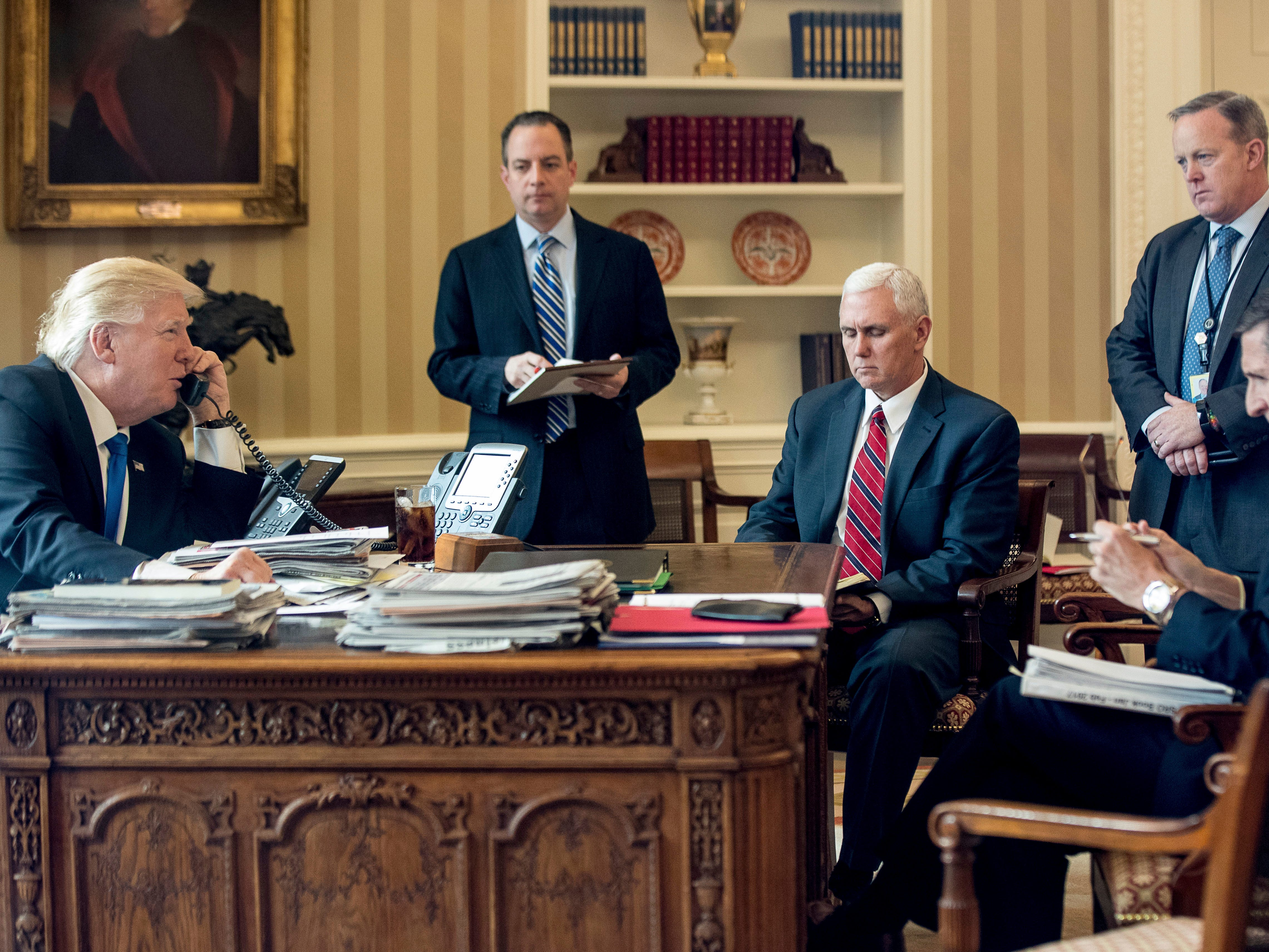 President Donald Trump (from left), accompanied by Chief of Staff Reince Priebus, Vice President Mike Pence, White House press secretary Sean Spicer and National Security Adviser Michael Flynn speaks on the phone with Russian President Vladimir Putin, in the Oval Office at the White House.