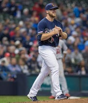 Milwaukee Brewers pitcher Corbin Burnes reacts after giving up a run to the St. Louis Cardinals during the third inning of a baseball game Wednesday, April 17, 2019, in Milwaukee. (AP Photo/Darren Hauck) ORG XMIT: WIDH108