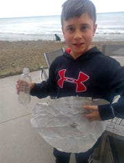 Mason Bentley, 11, of Greendale, found this message in this bottle on the Lake Michigan shoreline of his grandparents' house in Oostburg last weekend. The bottle was tossed in the lake by a teenage passenger on the SS Badger ferry in 1998.