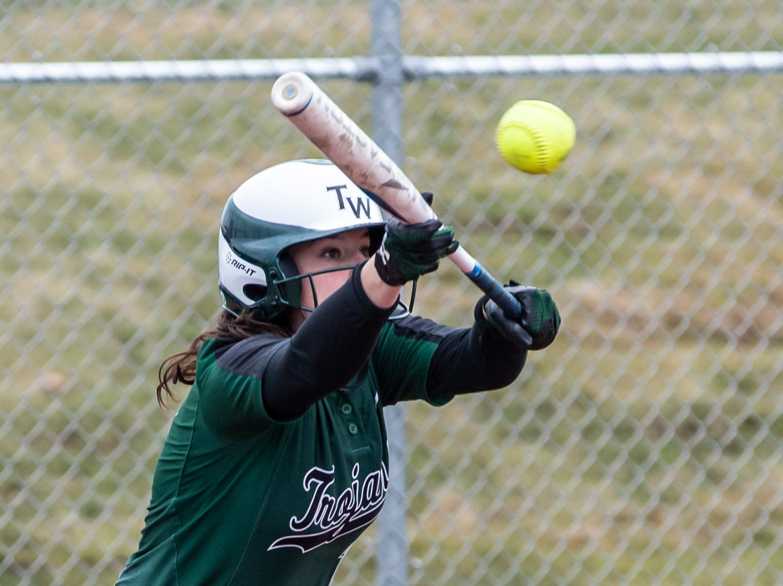Wauwatosa West's Tess Helbig lays down a bunt during the game at home against DSHA on Wednesday, April 17, 2019.