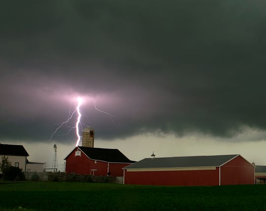 A lightning bolt flashes brightly over a farm along 7-mile road West of I-94 in Racine County. Journal Sentinel file photo