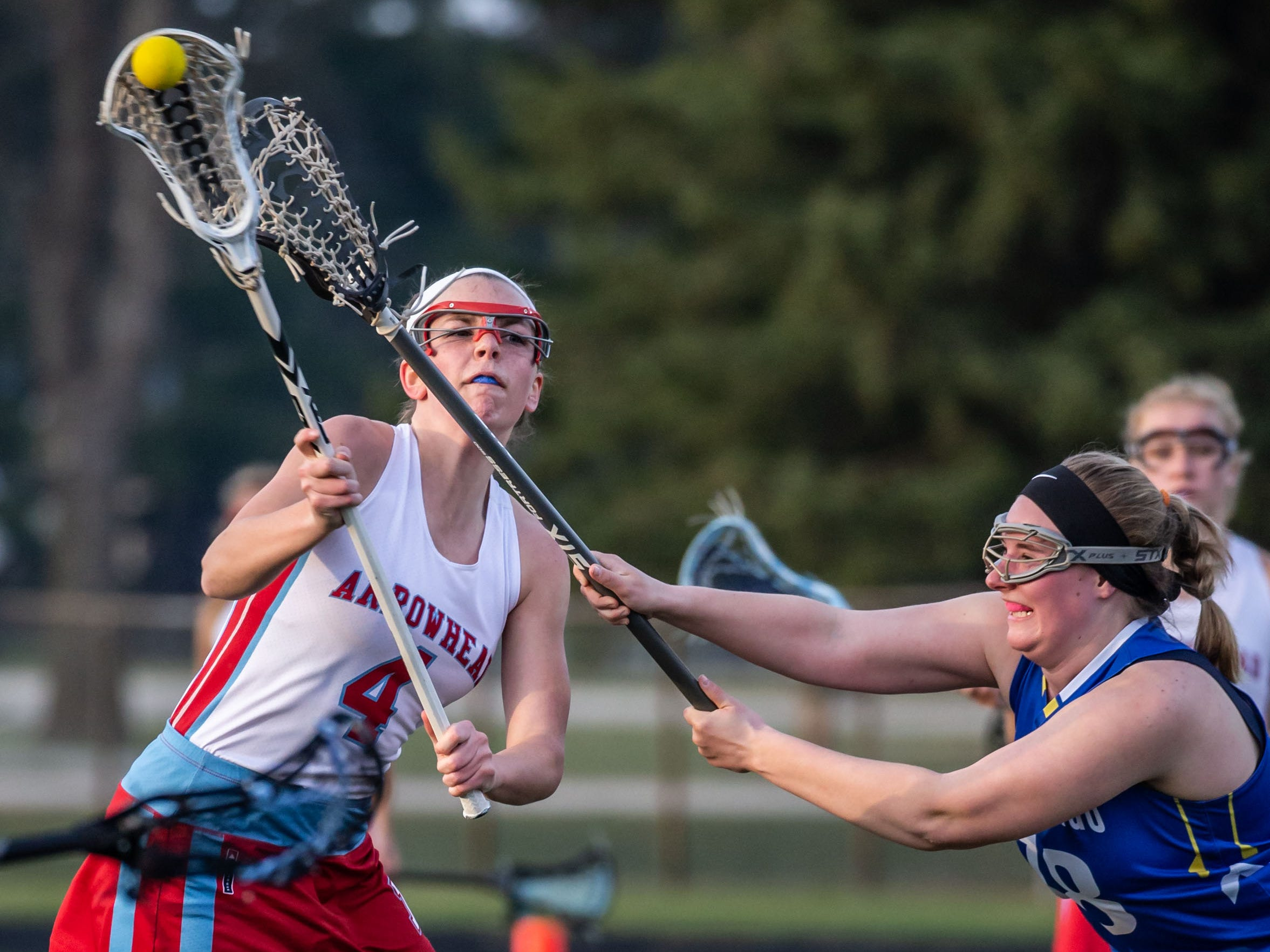 Arrowhead's Kylee Manser (4) scores during the game at home against Mukwonago on Tuesday, April 16, 2019.