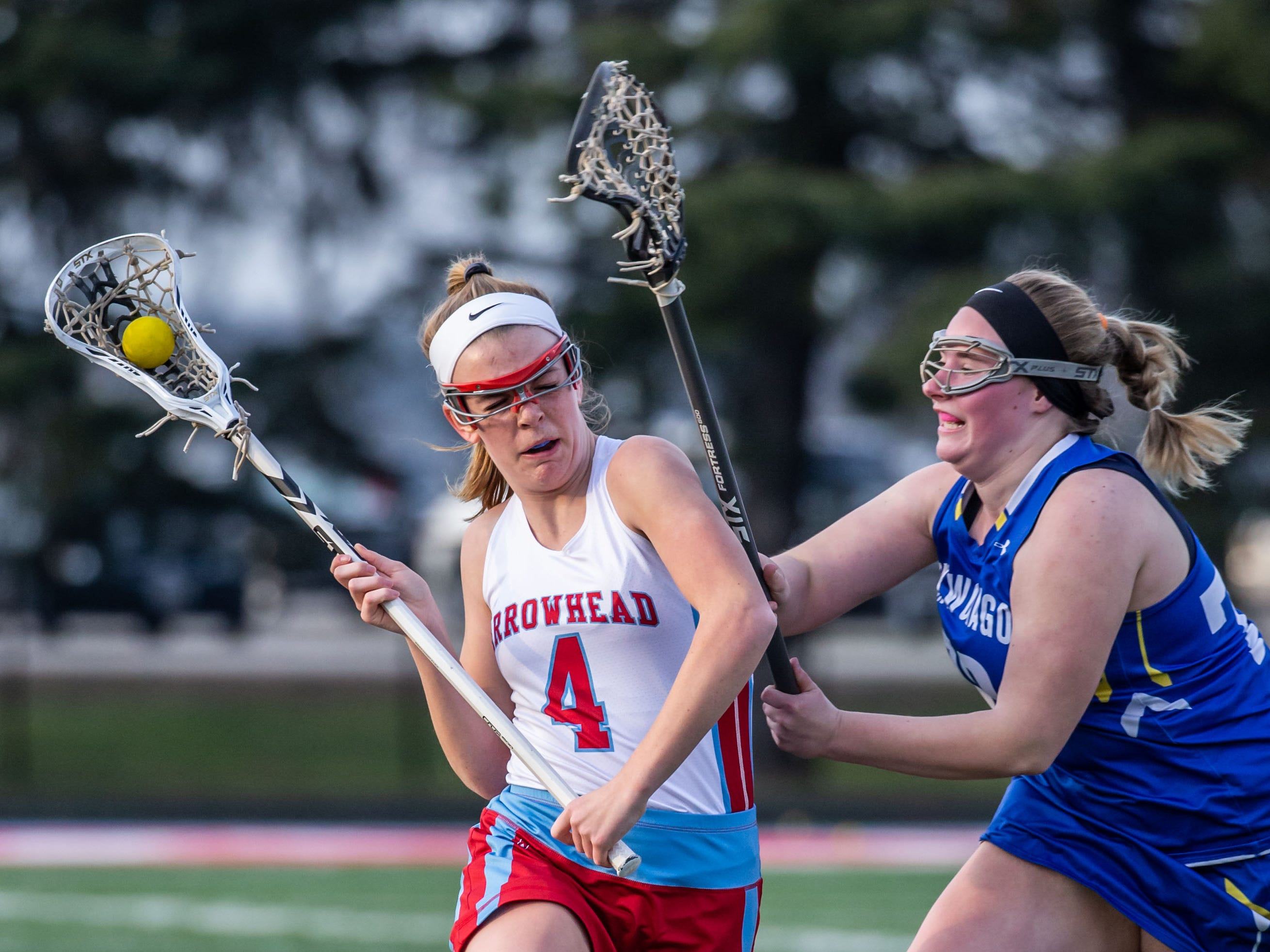 Arrowhead's Kylee Manser (4) battles to get past Mukwonago's Kaylee Graves (78) during the game at Arrowhead on Tuesday, April 16, 2019.